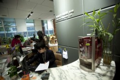 Workers browse books in the library and bookstore at Alibaba.com Ltd.'s headquarters in Hangzhou, Zhejiang Province.