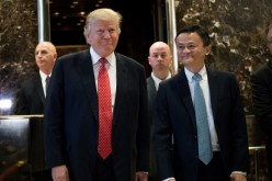 President-elect Donald Trump and Jack Ma, chairman of Alibaba Group, emerge from the elevators to speak to reporters following their meeting at Trump Tower, Jan. 9, 2017 in New York City.