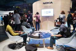 Attendees wear Samsung Gear VR virtual reality headsets to demonstrate the Ozo, a virtual reality camera, manufactured by Nokia Oyj, on the Nokia booth during the Slush startups event in Helsinki, Finland, on Wednesday, Nov. 30, 2016.