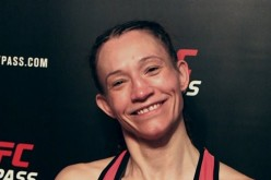 Amy Montenegro smiles for the cameras during her Invicta 21 post-fight interview last Jan. 14 at the Sottish Rite Temple in Kansas City, Missouri.