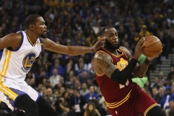 LeBron James of the Cleveland Cavaliers is guarded by Kevin Durant of the Golden State Warriors at ORACLE Arena on January 16, 2017 in Oakland, California.