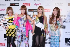 2NE1 poses for photographs on the red carpet of the MTV Video Music Awards Japan 2012 at Makuhari Messe on June 23, 2012 in Chiba, Japan.