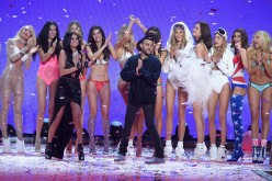 Selena Gomez and The Weeknd walk the runway during the 2015 Victoria's Secret Fashion Show with Adriana Lima, Behati Prinsloo, Lily Aldridge, Alessandra Ambrosio, Stella Maxwell and other models.