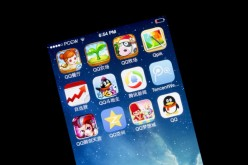 The application icons of Tencent Holdings (owner of WeChat) are displayed on an Apple iPhone.
