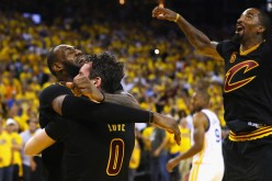 LeBron James, Kevin Love, and J.R. Smith of the Cleveland Cavaliers celebrate after defeating the Golden State Warriors 93-89 in Game 7 of the 2016 NBA Finals at ORACLE Arena on June 19, 2016 in Oakland, California.