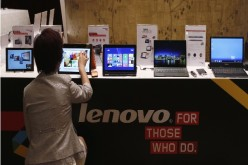 A woman doing hand-on on a Lenovo laptop.