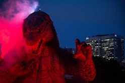 A 6.6 meter replica Godzilla is lit up during a press preview at Tokyo Midtown on July 17, 2014 in Tokyo, Japan.