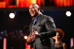 Actor Dwayne Johnson accepts the Favorite Premium Series Actor award for 'Ballers' onstage during the People's Choice Awards 2017 on Jan. 18, 2017.