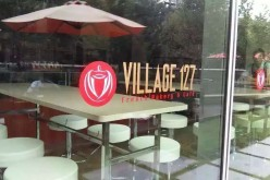 The facade of Village 127 French Bakery and Cafe