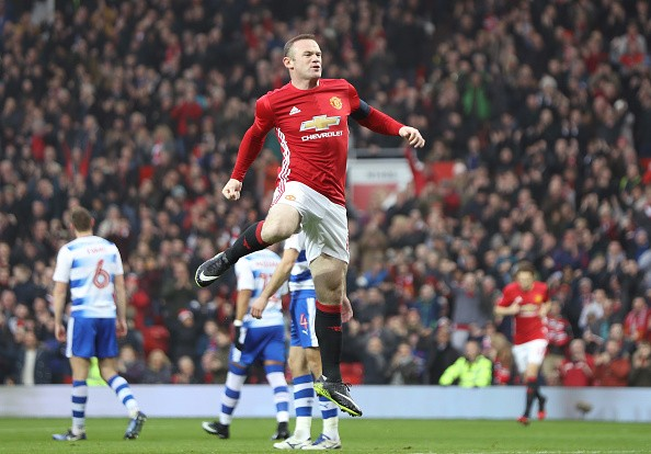 Even with a chance to earn an absurd amount of money in China, Wayne Rooney insists he is happy with Manchester United.
