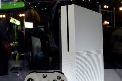 The new Xbox One S gaming console is on display in the Microsoft Corp. Xbox booth during the annual E3 2016 gaming conference at the Los Angeles Convention Center on June 14, 2016 in Los Angeles, California.