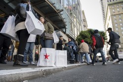 Shoppers stand outside Macy's, a U.S. mega-retailer that opened an online shop on Alibaba.com.