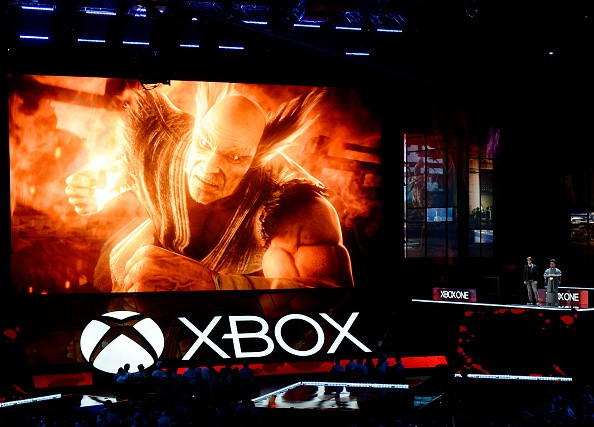 Katsuhiro Harada (R), and Michael Murray introduce 'Tekken7' video game during Microsoft Corp. Xbox at the Galen Center on June 13, 2016 in Los Angeles, California.