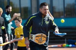 WWE superstar The Miz learning how to play cricket at a Chance to Shine coaching session at Ravenswood primary school on April 20, 2016 in Newcastle Upon Tyne, England.