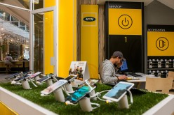 Mobile handsets and smartphones sit on display inside an MTN Group Ltd. telecommunications store in Hyde Park District of Johannesburg, South Africa.