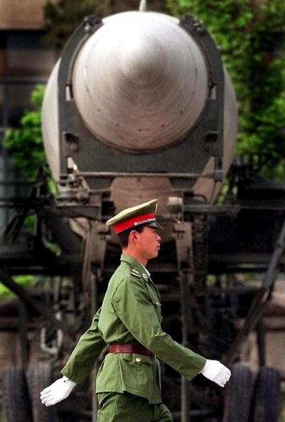 A Chinese People's Liberation Army (PLA) soldier walks past a medium-range ballistic missile on display at Beijing's Military Museum.
