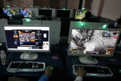 Young gamers play online games at an Internet bar in Huaibei in Anhui, China.