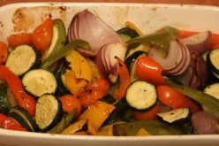 Roasted Mediterranean vegetables are presented in a container for tasting.