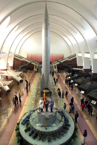 Beijingers pose for pictures in front of tanks, jets and of one of China's first nuclear missiles, the Dong Feng 1, as they visit the Military Museum of Chinese People's Revolution.