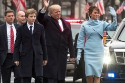 President Donald Trump and first lady Melania Trump, along with their son Barron, walk in their inaugural parade on Jan. 20, 2017 in Washington, DC. Donald Trump was sworn-in as the 45th President of the United States.