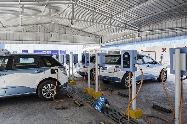 Electric taxis are plugged in to chargers at a charging station in Taiyuan, Shanxi Province.