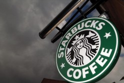 The Starbucks logo hangs outside one of the company's cafes in Northwich