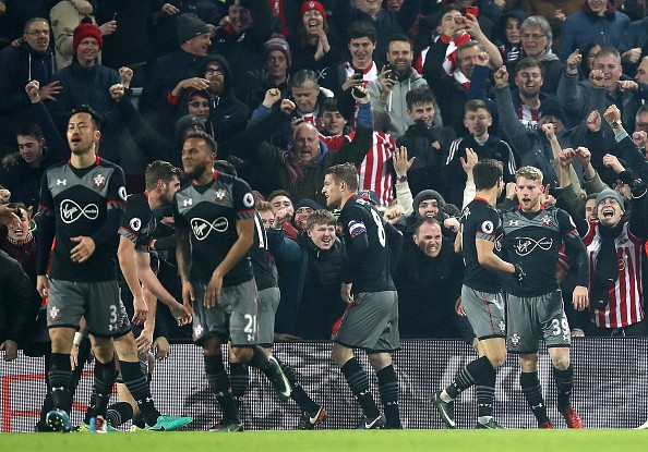 Players of Southampton FC celebrate after a goal.