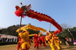 People celebrate the Lunar New Year with a dragon dance in Nantong, Jiangsu Province.