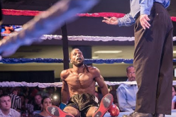 Roshaun Jones on the canvas after being knocked down by Cande Rochin in a boxing match last July 18, 2015.
