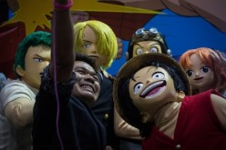 Visitor takes a selfie with cosplayers dressed as 'One Piece' characters during the Bangkok Comic Con 2016 Festival at Bitec Exhibition Centre in Bangkok, Thailand on April 29, 2016.