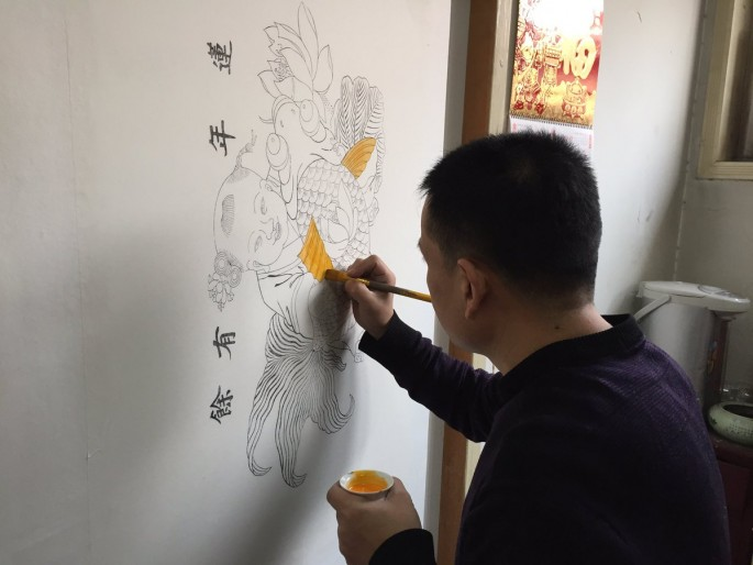 Huo's family has been making woodprint New Year paintings for seven generations, and the clan shows no signs of stopping the practice.
