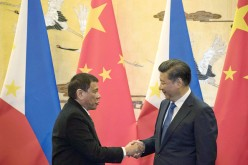 Chinese President Xi Jinping (R) shakes hands with Philippine President Rodrigo Duterte during a signing ceremony at the Great Hall of the People in Beijing last year.