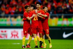 Chinese players celebrate after winning the game.