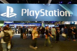 Gamers visit the PlayStation booth during a video game conference.
