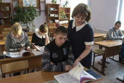 English language and psychology teacher Vera Bukhgolts talks to one of her students at a village school in Turuntayevo, Tomsk District, Russia.