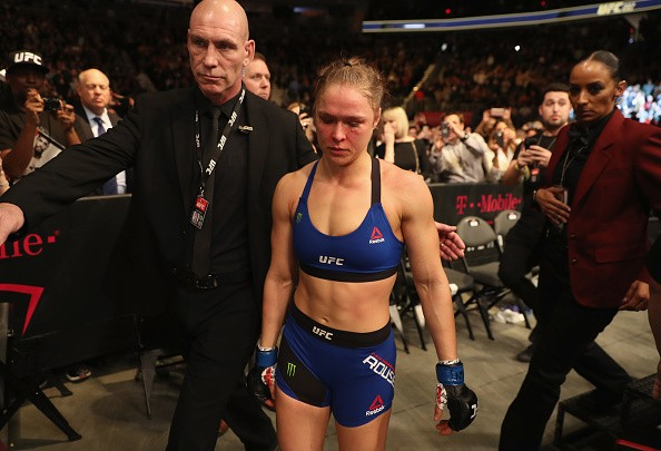 Ronda Rousey exits the Octagon after her loss to Amanda Nunes of Brazil in their UFC women's bantamweight championship bout during the UFC 207 event on December 30, 2016 in Las Vegas, Nevada.
