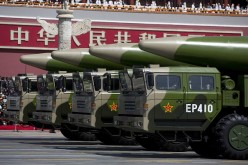 Military vehicles carrying DF-26 ballistic missiles drive past the Tiananmen Gate during a military parade on Sept. 3, 2015 in Beijing, China.
