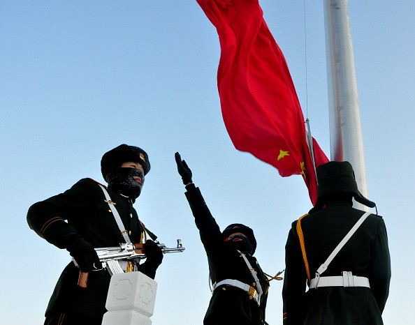 Armed police officers attend a flag-raising ceremony to celebrate new year in Greater Khingan Mountains on January 1, 2016 in Mohe, Heilongjiang Province of China.