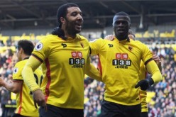 Watford's Troy Deeney (left)