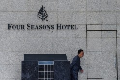 A man walks past the hotel where Chinese billionaire Xiao Jianhua was reportedly abducted by mainland security agents last month.