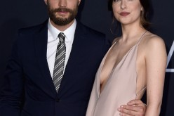 Actors Jamie Dornan and Dakota Johnson attends the premiere of Universal Pictures' 'Fifty Shades Darker' at The Theatre at Ace Hotel on February 2, 2017 in Los Angeles, California.