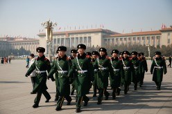 Chinese paramilitary police officers patrol Tiananmen Square.