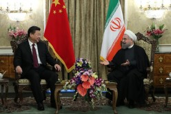 Chinese President Xi Jinping and Iranian President Hassan Rouhani pose during a meeting at Saadabad Palace in Tehran, Iran, on Jan. 23, 2016.