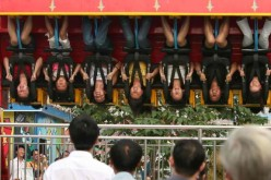 A 13-year-old girl died after she was thrown from a spinning ride in a Chongqing amusement park.