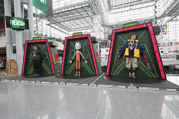 Fans pose for photos in the 'Rick and Morty' Galactic Federation Prison at at New York Comic Con on October 8, 2016 in New York City.