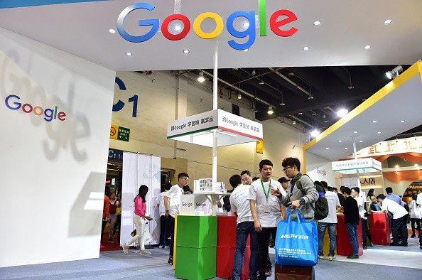 Visitors gathering at a Google booth during the 2016 China International Electronic Commerce Expo in Yiwu, east China's Zhejiang Province.