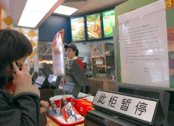 A consumer buys food at a Kentucky Fried Chicken outlet in Beijing, China.