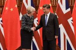 Chinese President Xi Jinping shakes hand with British Prime Minister Theresa May before their meeting at the West Lake State House on Sept. 5, 2016, in Hangzhou, China.