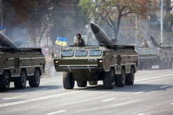 SS-21 missiles on their wheeled launchers.