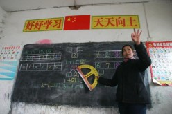 A teacher gestures as she gives a class at Xinxing School, a primary school for migrant children, Dec. 30, 2004, in Beijing, China.